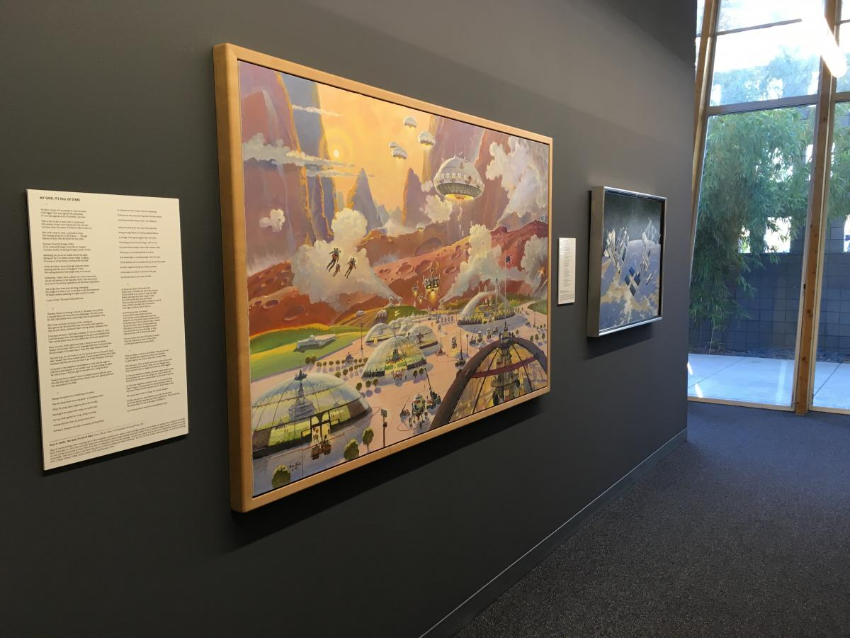 A large painting depicting a future human community on Mars displayed next to a poem.