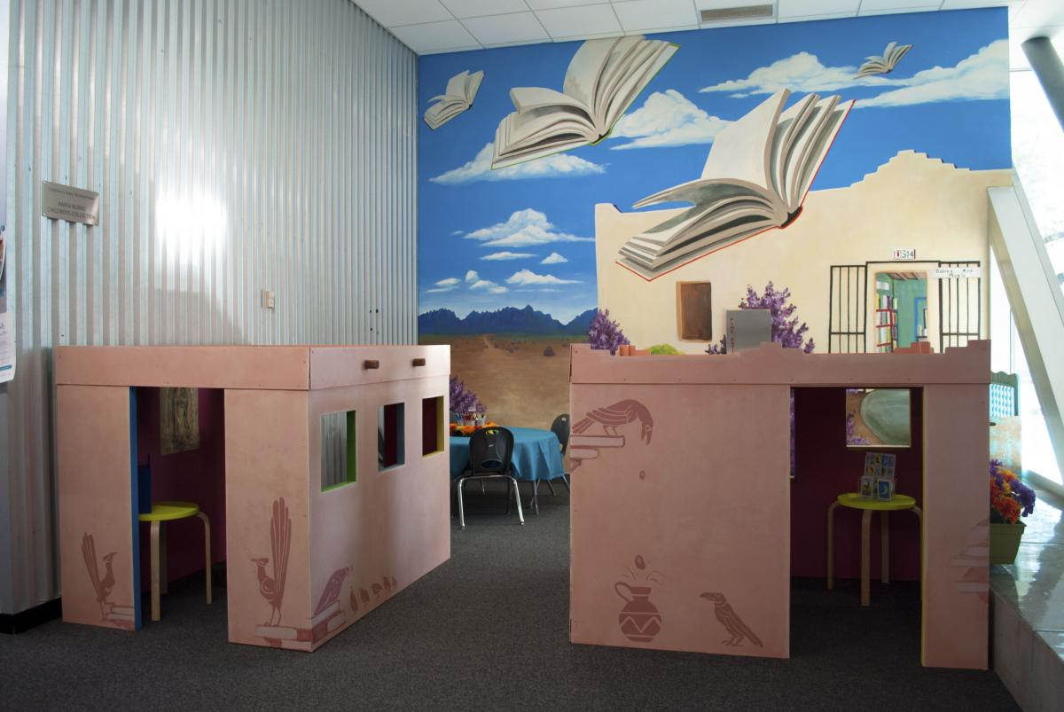 Brave Books area, with adobe playhouses and mural