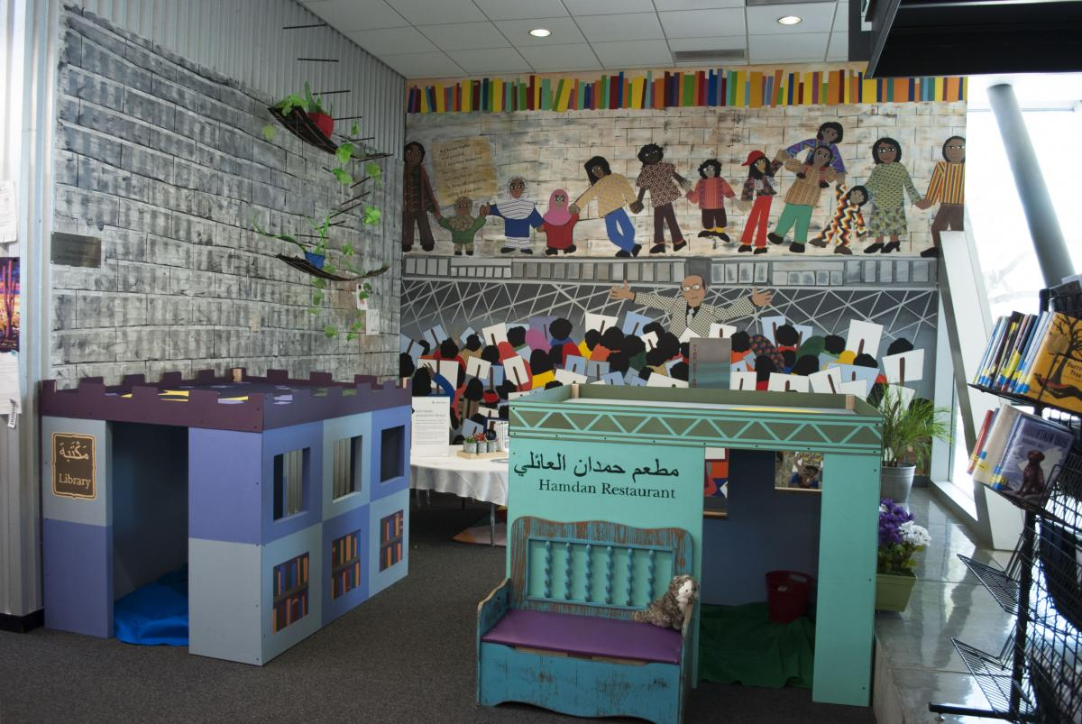 Image of the children's area, including a mural and playboxes