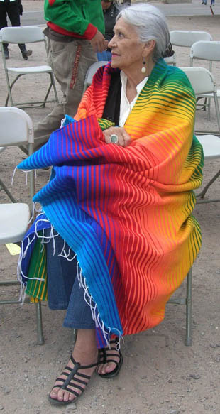 Faride Conway wrapped in a rainbow serape