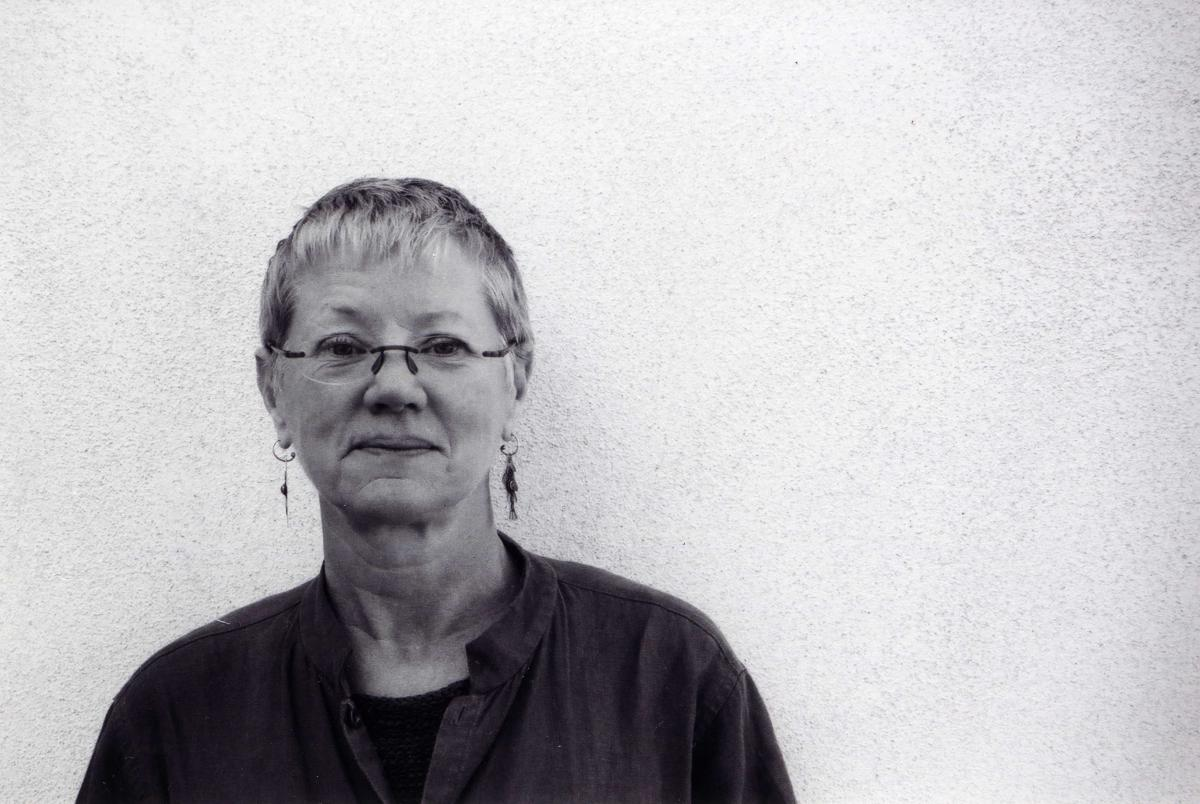 black and white portrait of Linda Gregerson against a white wall