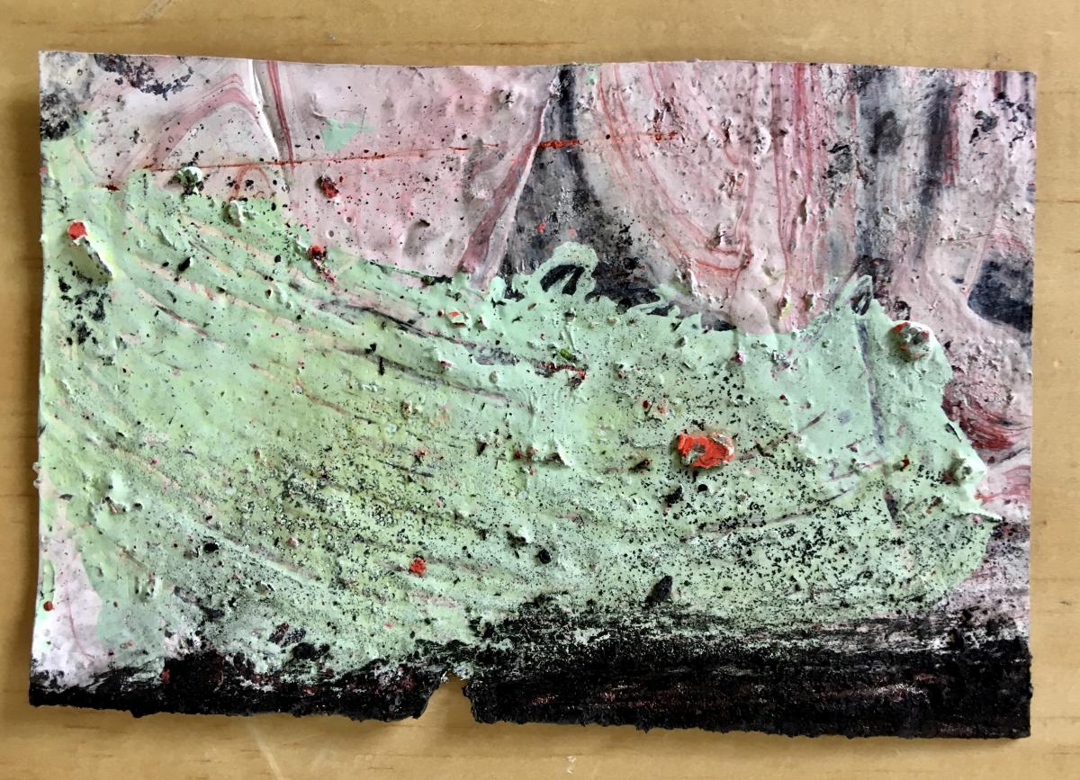 The front of a postcard painted in abstract swirls of green and pink.