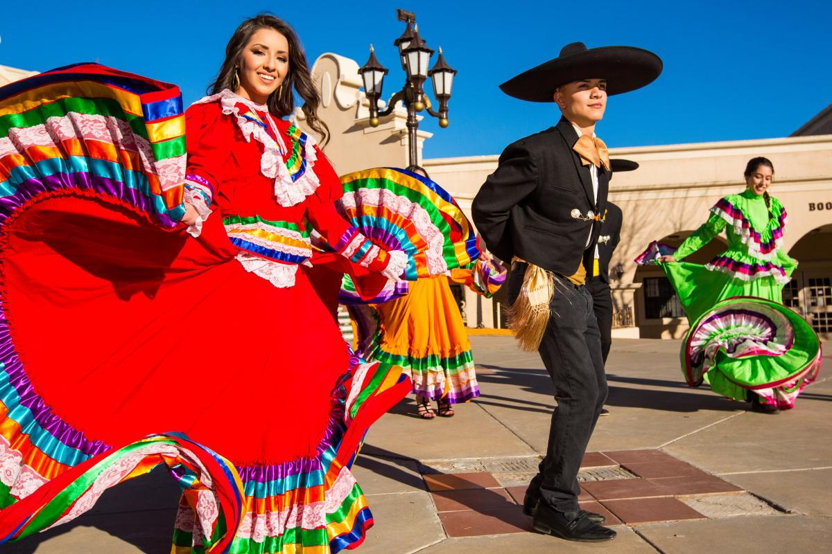 Adults in folklorico costumes // photo by Lloyd Blunk