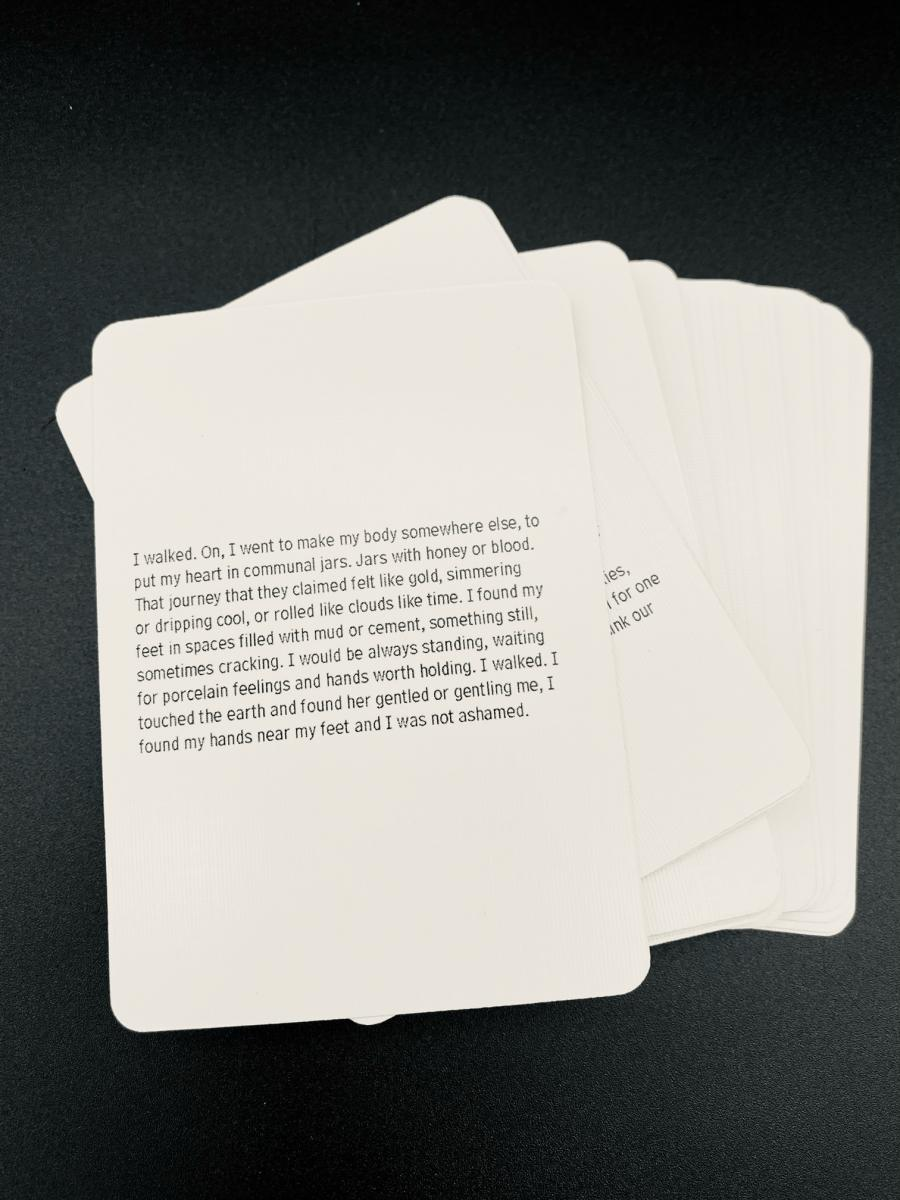 """Photo of text side of playing cards from """"Playing House."""""""