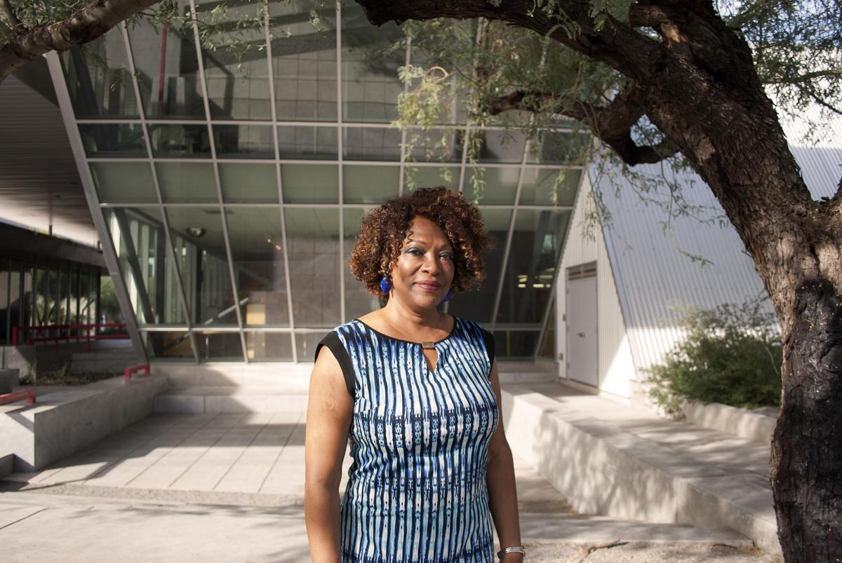 Rita Dove stands in front of a glass wall at the Poetry Center