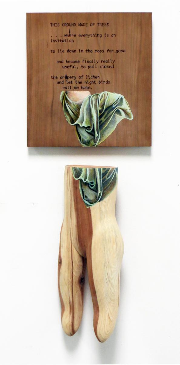 "Wood sculpture of ""This Ground Made of Trees"""
