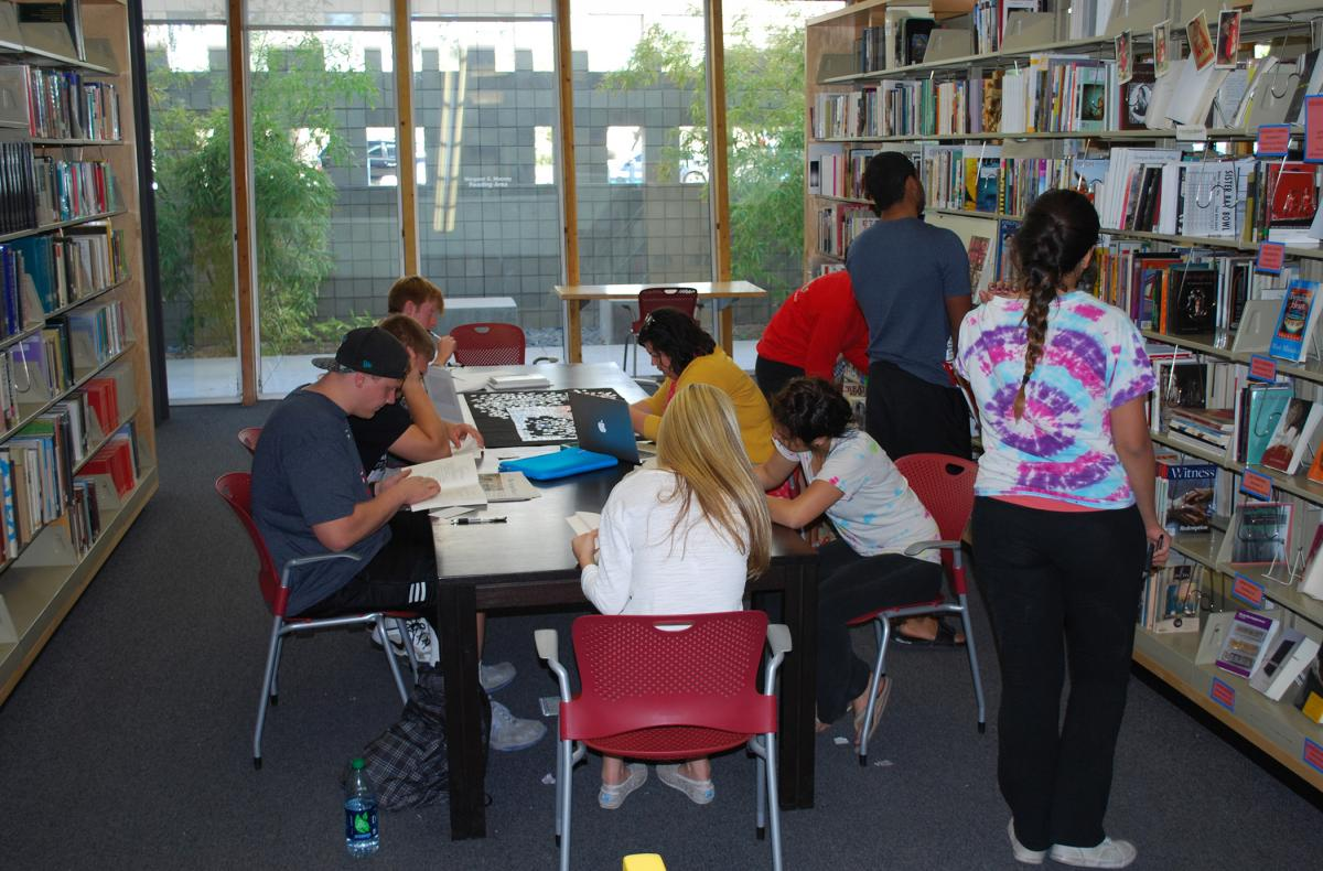 University of Arizona students browse Poetry Center collections during a field trip.
