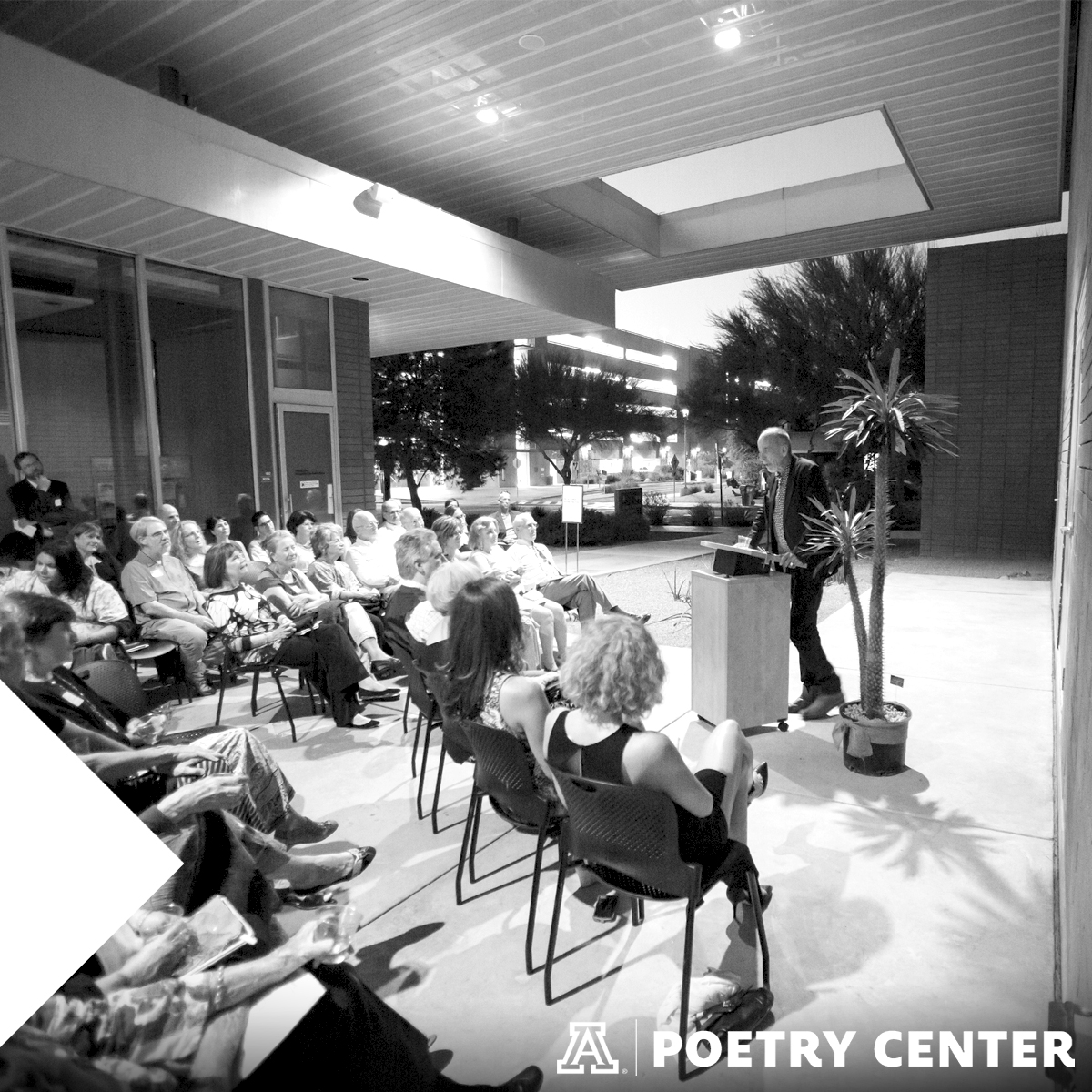 Audience watches poet read in Poetry Center breezeway