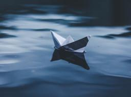 paper boat on water