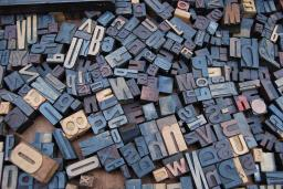 a drawer full of letterpress letters of various shapes and sizes