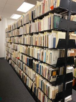 Photo of full shelving space in the Poetry Center's Archives room