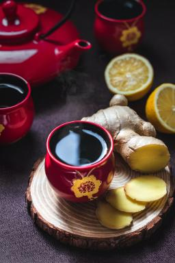 Ginger and lemon tea in a red cup, image by Eiliv-Sonas Aceron