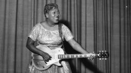 Sister Rosetta Tharpe plays guitar on stage