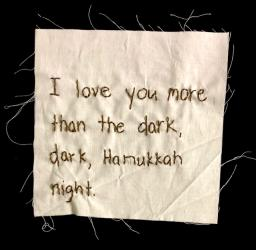 "Embroidery reading, ""I love you more than the dark, dark Hanukkah night."""
