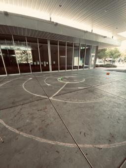 Photo of chalk labyrinth drawn in the Poetry Center breezeway