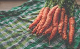 Carrots on a green checked cloth, photo by Monika Stawowy