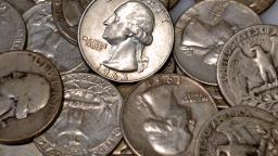 A pile of Washington eagle quarters