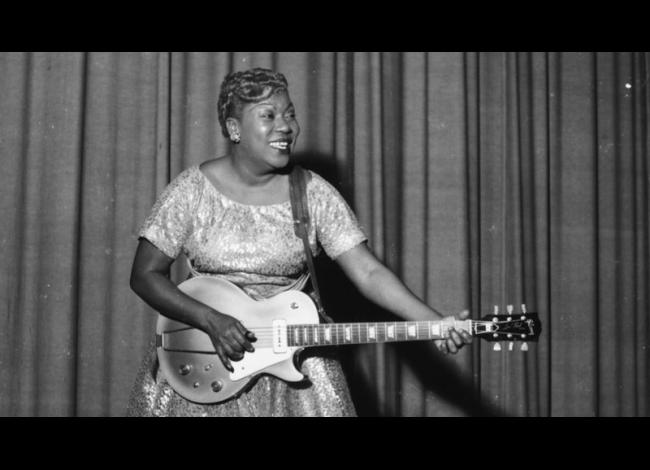 Sister Rosetta Tharpe plays guitar on stage