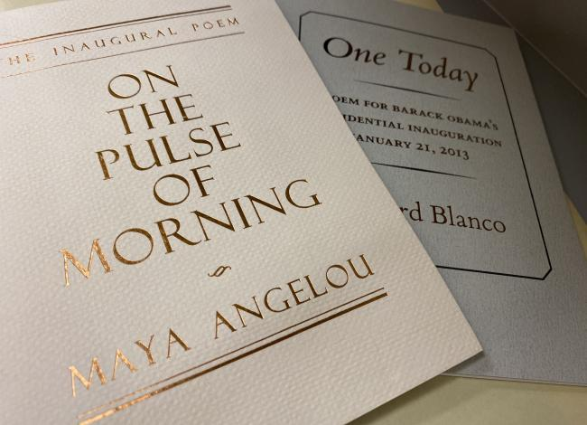 Photo of two chapbooks containing inaugural poems by Maya Angelou and Richard Blanco.