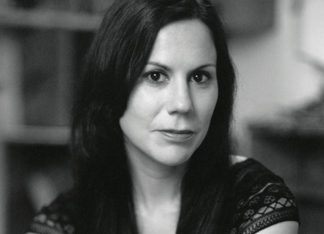 Jennifer Foerster looking directly into the camera, in black and white