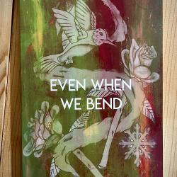 """Book that reads """"Even when we bend"""" with a hummingbird, snowflake, and roses on it"""