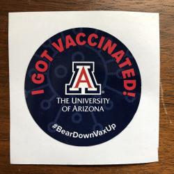 "A round sticker that read ""I got vaccinated"" above the logo of the University of Arizona."