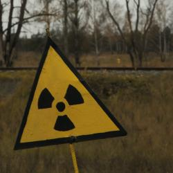 radioactive sign in front of a field