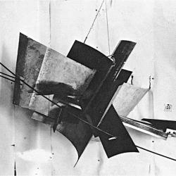"A black and white photo of a metal sculpture, ""counter-corner relief"""